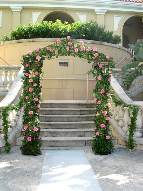 Garden wedding arch covered with ivy and pink roses