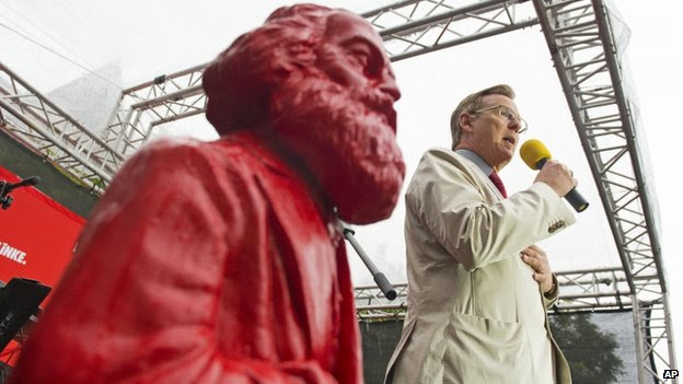 Bodo Ramelow file pic - with bust of Karl Marx beside him