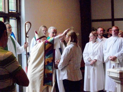 Bishop Price performs confirmation