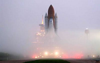 In today's morning fog, Space Shuttle Atlantis rolled out to Launch Pad 39B in preparation for the next space station assembly flight, STS-115.