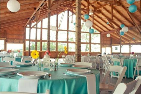 rinia wedding venue teal white red yellow tablescapes