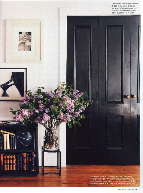 black double doors and contrasting white walls