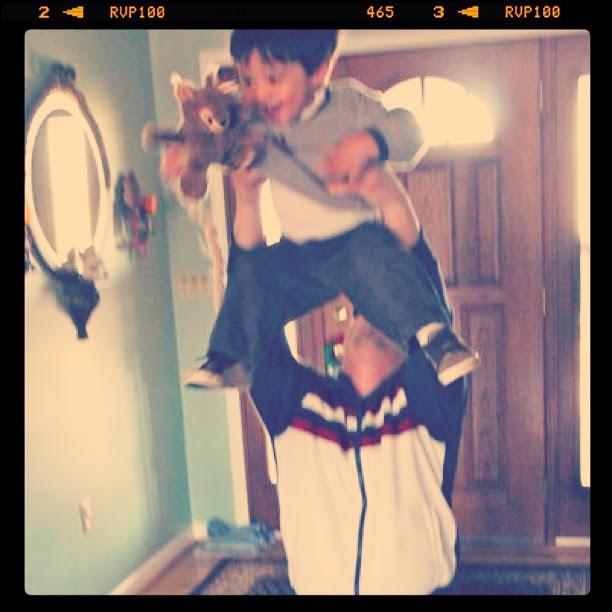 Ryan tossing Owen in the air