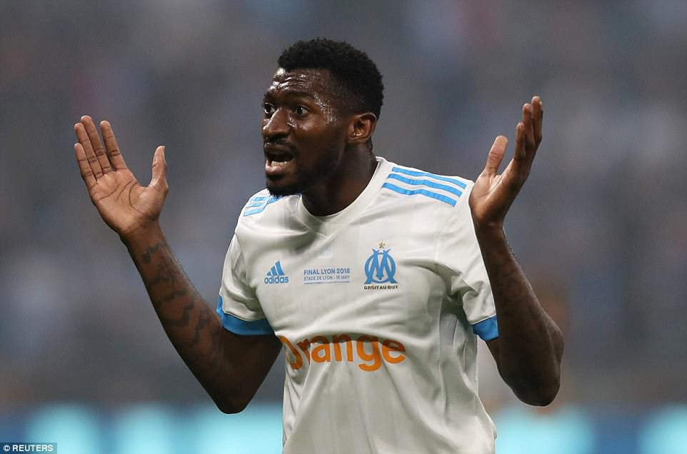 Marseille's Andre-Frank Zambo Anguissa reacts with a guilty look after giving the ball away that allowed Griezmann to score
