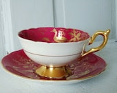 Vintage Ruby Red Flora and Fauna Tea Cup and Saucer