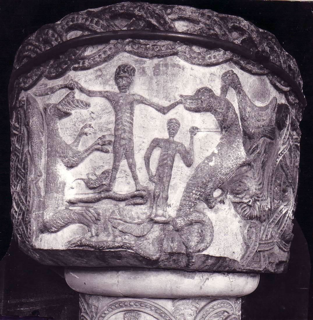 Carving on the font at Stone