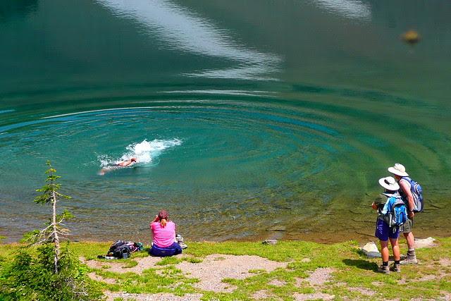 P1160634 Hikers Swimming in Ptarmigan Lake, Glacier National Park