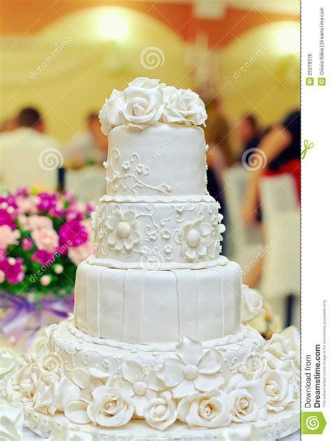 White Floral Wedding Cake On Restaurant Background Stock