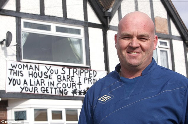 Acrimonious: Lorry driver Robin Baker, 45, has publicly vented his feelings towards his estranged wife on a homemade sign on the front of his house