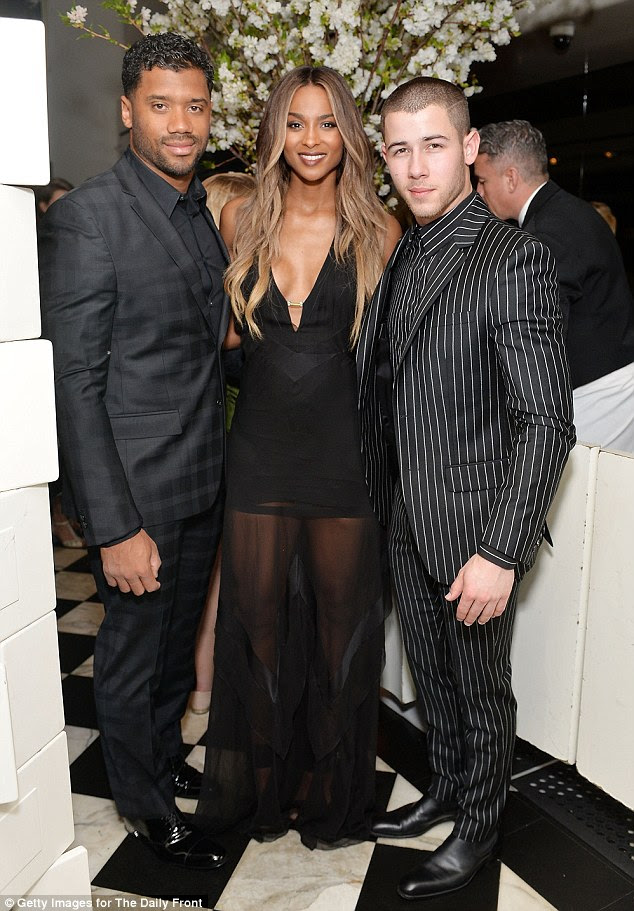 Handsome sandwich: The couple were also joined by Nick Jonas at the gathering