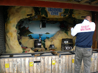 Playing the Treasure Cove shooting gallery at Blackbeard's Treasure Island in Eastbourne