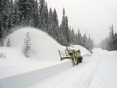 Snowblower shooting snow - SR 20, North Cascades Highway