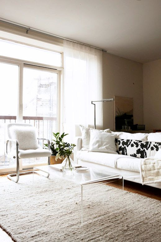 Le Fashion Blog -- A Fashionable Home: Bernadette Pascua's Williamsburg, Brooklyn Apartment -- Livingroom, Lucite Coffee Table, Chrome Chair, White Rug -- Via Design Sponge photo Le-Fashion-Blog-A-Fashionable-Home-Bernadette-Pascua-Williamsburg-Brooklyn-Apartment-Lucite-Coffee-Table-Livingroom-edit.jpg