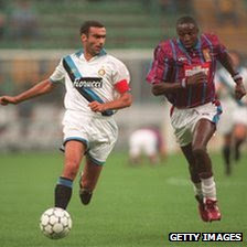 John Fashanu (r) chases for the ball with Bergomi during the UEFA Cup first leg tie in 1994