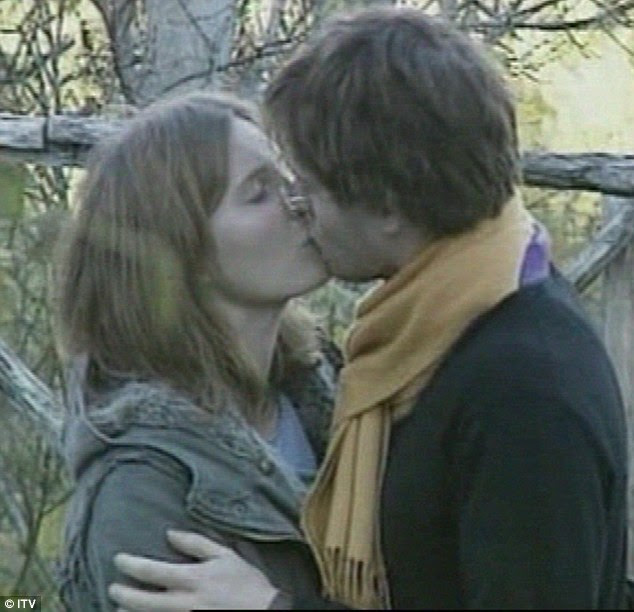 Amanda Knox and Raffaele Sollecito in their infamous clinch after they were named as suspects in Ms Kercher's murder. Sollecito now claims their stories on the night of Ms Kercher's death are not 'intertwined'