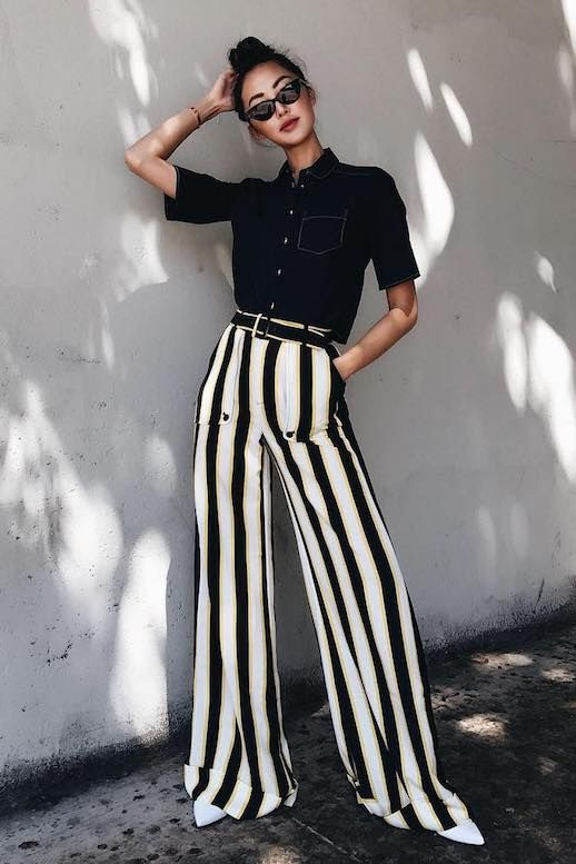 Le Fashion Blog 11 Pairs Of Striped Trousers Pants To Buy For The Fall Via Chriselle Lim