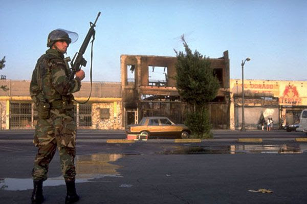 A U.S. Marine Corps soldier patrols Crenshaw during the 1992 Los Angeles riots.