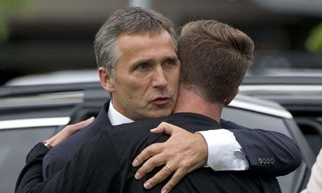 Jens Stoltenberg embraces survivor