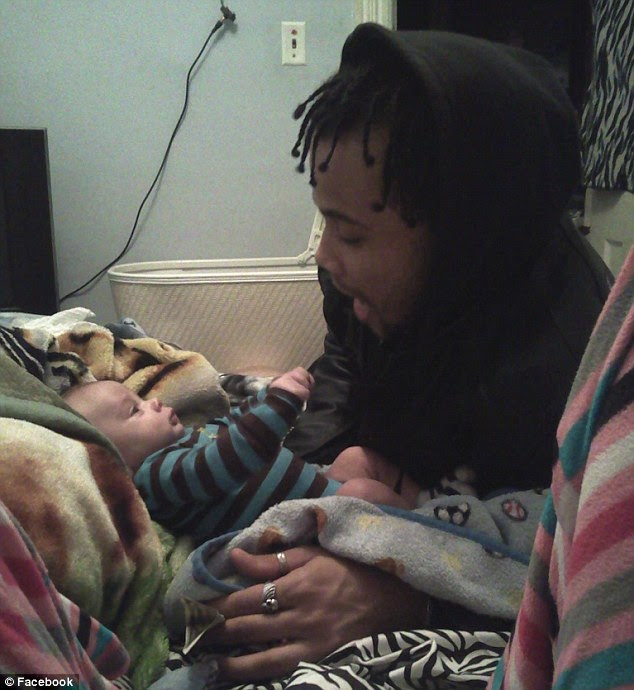 Happy: Jevon Wameling, seen here with his son Levon, was the last person to see him before the baby went missing in May