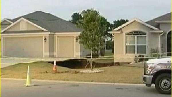 A sinkhole opened up on Saturday beneath two houses in Florida.