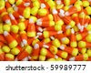 Yellow orange and white candy corn halloween candy - stock photo