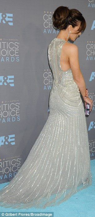Figure-hugging: The English actress' gown was sleeveless and fit her slender form snugly before withdrawing into a trailing train