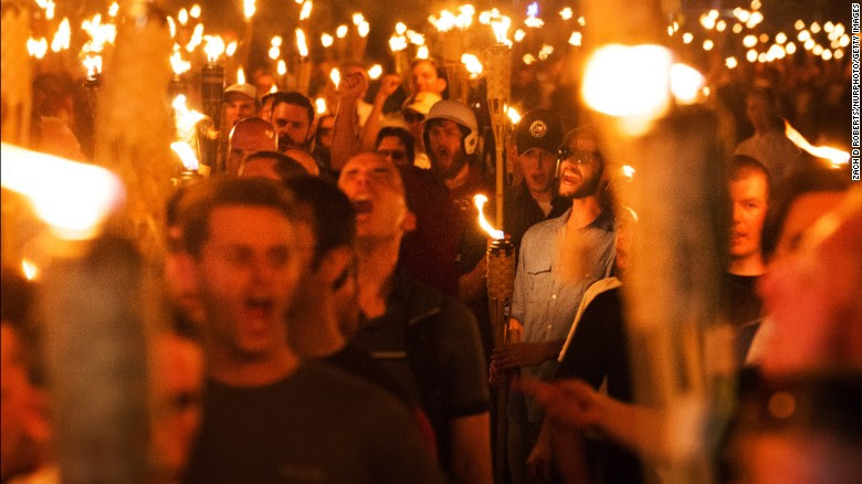 White nationalists and others march Friday night through the University of Virginia campus.