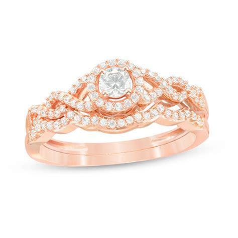 3/8 CT. T.W. Diamond Frame Twist Bridal Set in 10K Rose