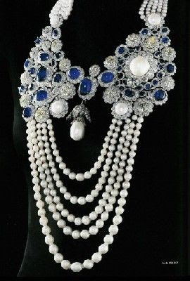 La Regente Pearl (center) is the 5th largest pearl in the world and perhaps the largest pearl of a regular shape, and was given as a gift by Emperor Napoleon I to his second wife and Queen Consort Marie Louise in 1811. Here, it is mounted on a modern pearl, sapphire and diamond necklace...