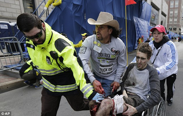 Iconic image: Jeff Bauman, 27, was depicted in the extremely graphic picture being carried away from the scene of the explosion with his legs severed below the knee