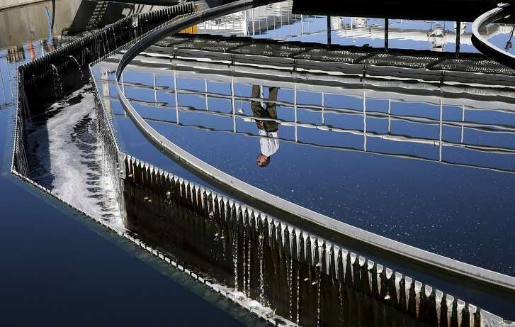 Plant operations manager Dan Gallagher is seen reflected in a secondary clarifier as recycled water travels through the cleaning process, during a tour of the Dublin San Ramon Regional Wastewater Treatment Facility in Pleasanton, Calif. on Tues. September 22, 2015.