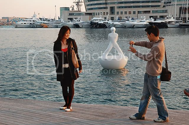 Taking Photographs at Port Vell, Barcelona: Romantic Couple [enlarge]