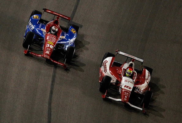 Justin Wilson of England, driver of the #18 Sonny's BBQ Honda Dallara, passes Graham Rahal, driver of the #38 Service Central Honda Dallara, in the final laps for the win during the IZOD IndyCar Series Firestone 550 at Texas Motor Speedway on June 9, 2012 in Fort Worth, Texas.
