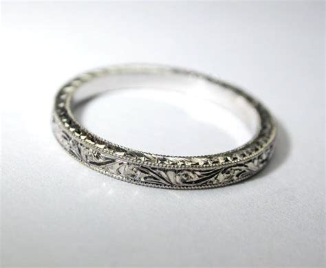 $375, hand engraved 14k white gold thin wedding band. 2 mm
