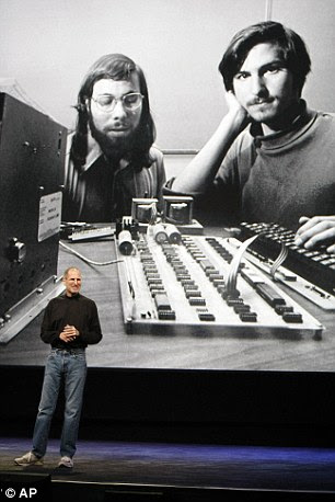 Here, the late Steve Jobs shows an image of himself and Wozniak in the early days of Apple, at an event
