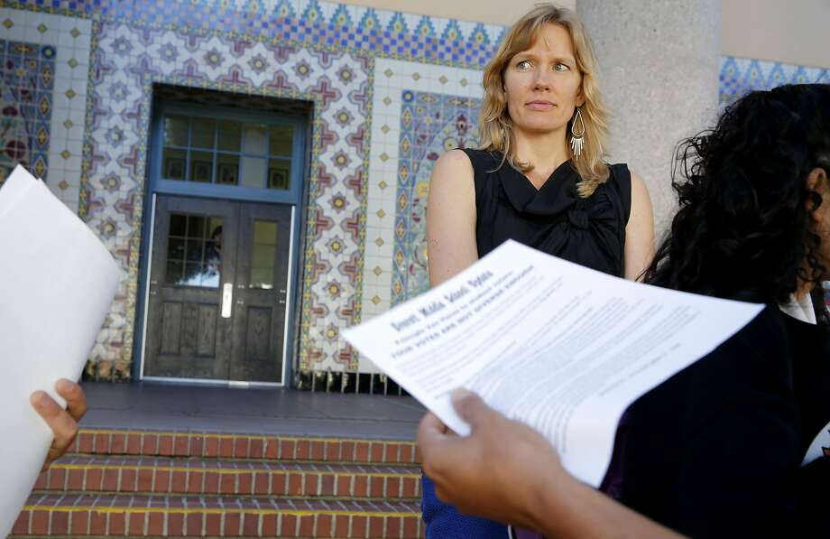 Principal Lena Van Haren looks at Alexander Rowson as he and Jerome Palma debate how race impacts politics outside Everett Middle School in San Francisco, California, on Monday, Oct. 19, 2015. Photo: Connor Radnovich, The Chronicle