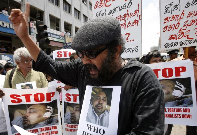 Sri Lankan journalists hold posters of Keith Noyahr, an editor and defence columnist, as they shout slogans against the government during a protest in Colombo May 23, 2008. REUTERS/Anuruddha Lokuhapuarachchi