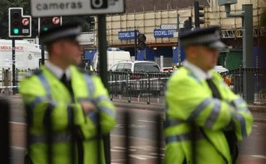 Police outside Stockwell Station - From Associated Press