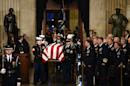 Late president Bush lies in state in Washington