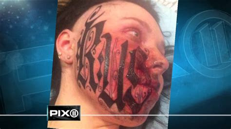 woman lets boyfriend tattoo face