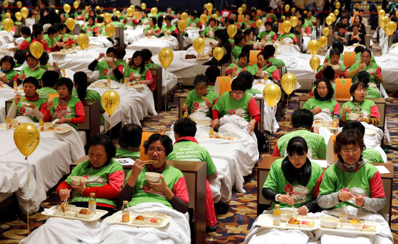 338 participants dine in bed at a hotel in Shanghai, China on November 12, to set the new record for 'maximum people taking breakfast in bed at a given place', outshining the previous record of 288 members from Women's Health Initiative on March 12, 2013 in Australia.
