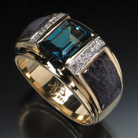 RANDY POLK DESIGNS: MEN'S RINGS. 9x7mm London blue topaz