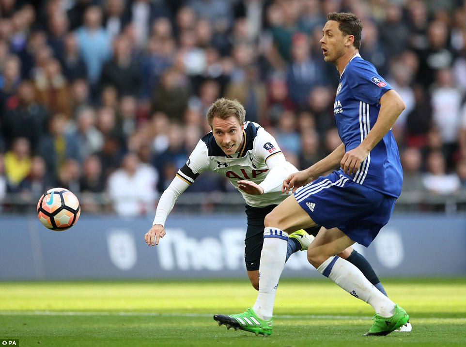 Tottenham midfielder Christian Eriksen heads towards goal but his effort is easily saved by Courtois