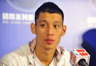 Jeremy Lin #7 of the Houston Rockets listens to during a news conference in Taipei on October 11, 2013