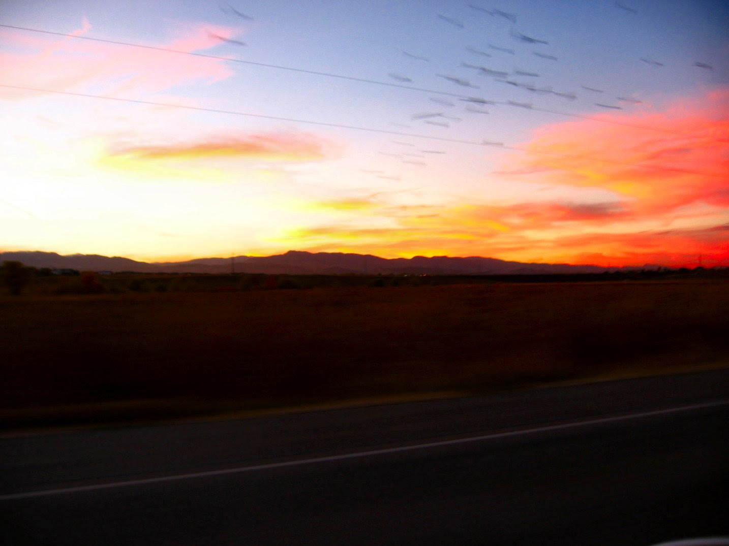 Horizon Sunrise Photo with Rocky Mountains in the Background Driving on Hight - photo by Mike Fisk - soul-amp.com