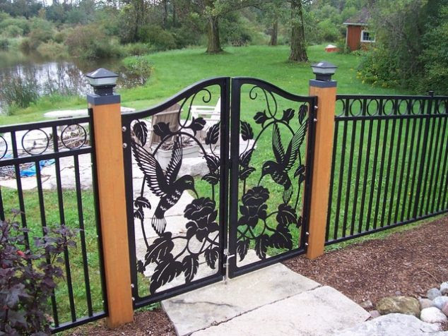 cool metal fence gate designs 12 custom metal gates eclectic home fencing and gates 634x476 15 Decorative Metal Gate Design for Amazing First Impression