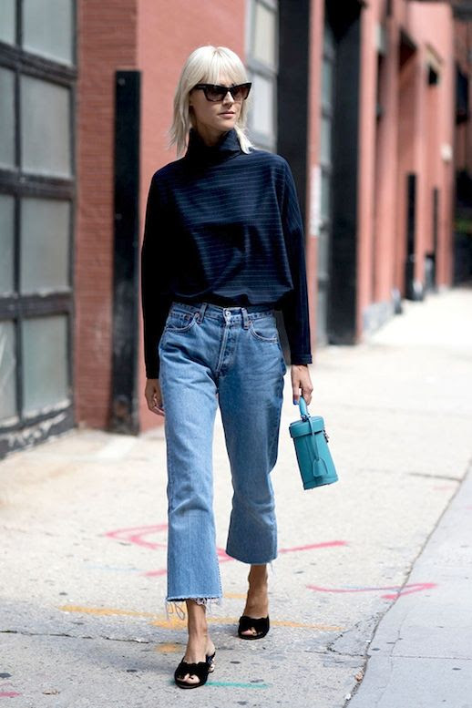 Le Fashion Blog Fall Street Style Nyfw Blonde Cat Eye Sunglasses Turtleneck Sweater Raw Hem Jeans Mini Blue Bag Via Style Caster