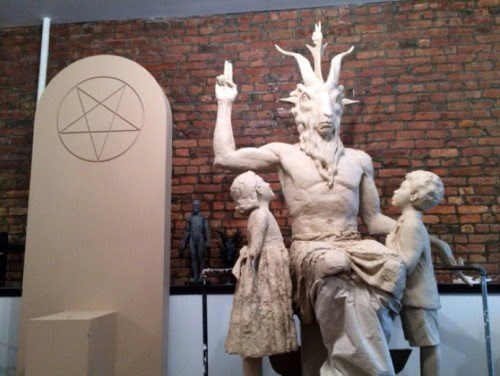 """Although the Temple of Satan claims that """"it does not believe in the supernatural"""", its statue features Baphomet doing the hermetic hand sign """"as above so below"""". It sits next to an inverted pentagram, the symbol of black magick."""