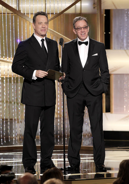 Tim Allen In this handout photo provided by NBC, Presenters Tom Hanks (L) and Tim Allen speak onstage during the Golden Globes at the Beverly Hilton International Ballroom on January 16, 2011 in Beverly Hills, California.