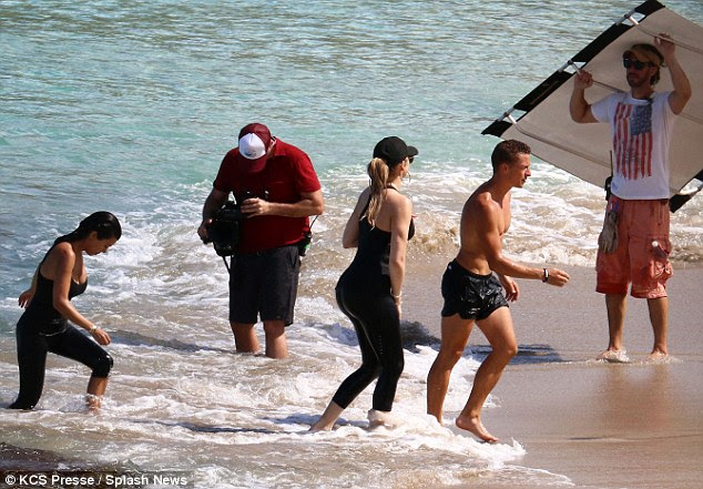 Hunky: The siblings were joined by a hunky personal trainer and a reality TV camera crew
